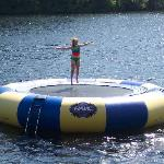 Laura on the water trampoline at Sunny Point Resort