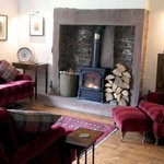 Relax in guest lounge in front of the wood burning stove
