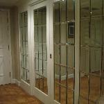 Glass door separating living and Bedroom