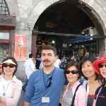 Ozkan is pausing for a group picture in front of Spice Market