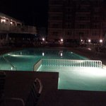 Pool lit up at night <3
