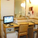 LCD TV, with Room Safe & mini fridge below & hairdryer on right, Electric kettle & bible on rack