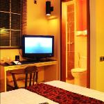 deluxe room flat screen tv and toilet