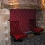 The fireplace, now alcove seating