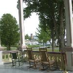 The front porch of the Atheneaum Hotel is a wonderful setting to relax and enjoy a summer day or