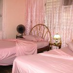 Bedroom with a double and single bed, ensuite, fridge, air conditioner