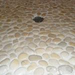Your feet on natural stones while you shower