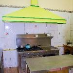 Large kitchen with commercial stove and grill