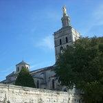 The lantern tower surmounted by the beautiful gilded statue of the Virgin surmounts the Romanesq