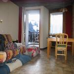 living/sleeping area with balcony