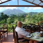 the awesome view of Arenal while enjoying breakfest