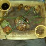 my entree -- that's pineapple atop chicken in the middle -- complete with stained cutting board