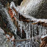 A cold winters day makes for intriguing ice formations on the waterfall at the back