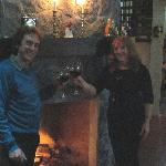 Enjoying a glass of red wine by the fireplace at Rio Magnolia