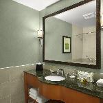 Custom tile and granite complete this modern bathroom design.