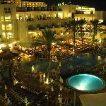 Night view of pools and restaurant from balcony