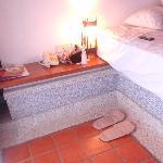 Comfortable platform bed and generous bedside shelf