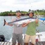 Loren (right) and I celebrating a 55lb Wahoo