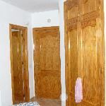 wardrobes on the right bathroom door to the left