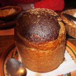 Lithuanian mushroom soup served in a rye bread loaf