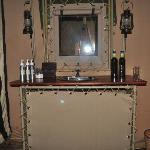 wash basin with a mirror, shampoo and soap