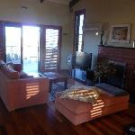 Villa: living room, view towards sun-deck