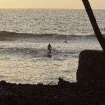 watching surfers at sunset from the pool-lanai