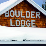Sign on top of the lodge in winter