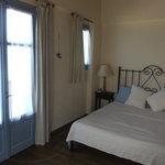 master bedroom with doors off to balcony & terrace