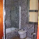 roomy bathroom with great water pressure and lovely tilework