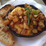 Ham and cheddar frittata with potatoes and toast