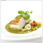 Baked Hake fish with a new style traditional garnish