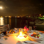 Seaside dining, overlooking the marina, the bay & the city lights.