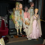 Several of the puppets backstage including Papageno to the left.