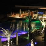 The entertainment area at night (pool, outdoor restaurant, outdoor furniture)