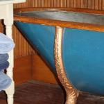 The beautiful zinc & carved wood tub