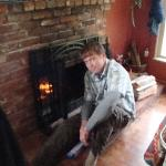 my fella in front of the fireplace on a former trip