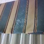 White crusty stains on curtain valance