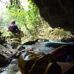 Lowering kayaks into the cave
