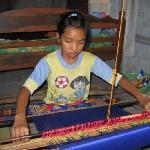 Girl weaving songket at Sukarara
