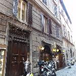 Baldassini huge entrance door on a narrow street close to Piazza Navona
