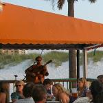 Local musicians perform live on the deck at grill and bar.