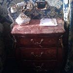 Bedside table with elegant phone in Deluxe Room