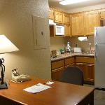 Kitchen has two burners, full fridge