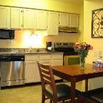 Full kitchens with refrigerator/freezer/ice maker, stove/range, microwave, dishwasher, flatware