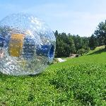 Zorbing on unique curved slope
