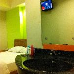 The room with dbl bed and a flat screen tv