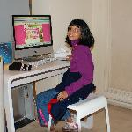 my duaghter enjoying surfing net in the lobby