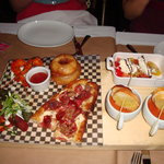 Onion rings, kobe beef taquitos, buffalo prawns, mini Italian pizza and the caprese salad