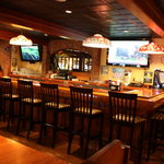 The bar featuring several big screen HDTV's. Happy Hour from 4-6 Monday-Friday